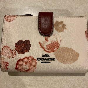 Cream floral coach envelope cc wallet